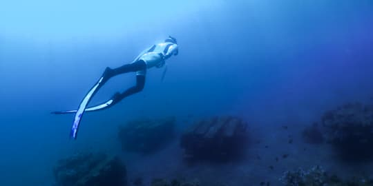 Freediver above an artificial reef