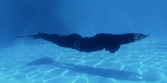 Freediver practicing in pool at Manado
