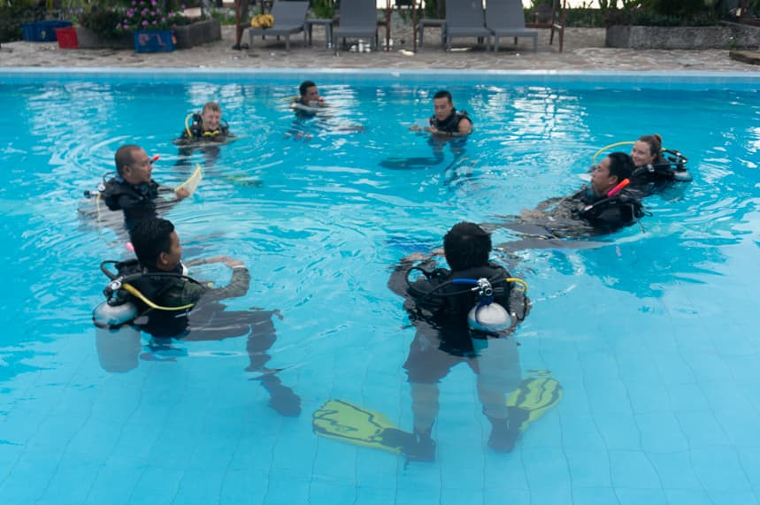 Instructor candidates in the pool doing exercises