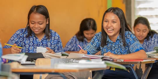 Manado students laughing in classroom of our diving and tourism school