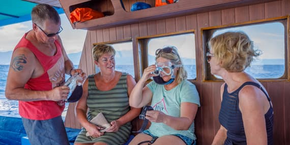 Guests testing a mask on our dive boat